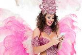Fotografie Frau im Karnevalskostüm mit Smartphone, isoliert auf weiss