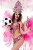 Fotografie smiling woman in carnival costume holding football ball and brazilian flag, isolated on white