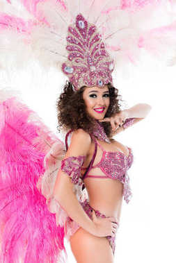 Cheerful woman posing in carnival costume with pink feathers, isolated on white stock vector