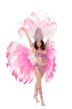 beautiful woman dancing in carnival costume with pink feathers, isolated on white