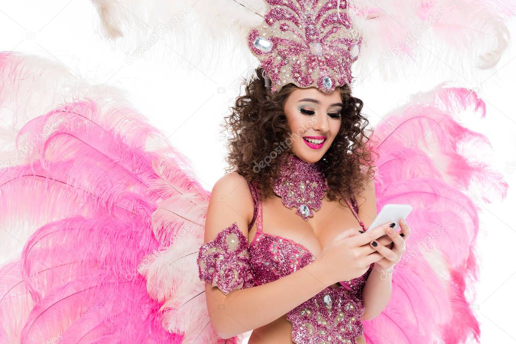 woman in carnival costume using smartphone, isolated on white