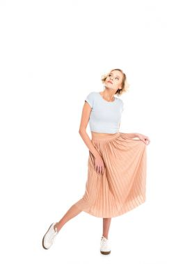 Full length view of beautiful blonde girl in pink skirt posing and looking away isolated on white stock vector