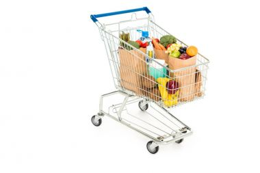 Grocery bags in shopping trolley isolated on white stock vector