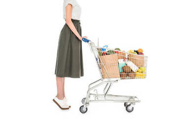 Side view of woman standing with shopping trolley with paper bags and grocery isolated on white stock vector