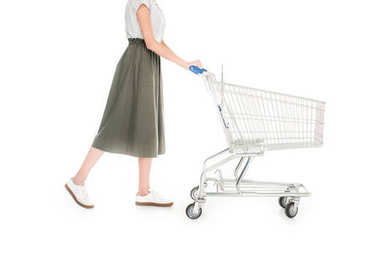 cropped shot of woman pushing empty shopping trolley isolated on white