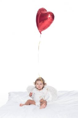 baby angel with wings and nimbus holding heart balloon, isolated on white