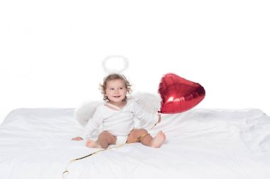 Little angel with wings and nimbus holding red heart balloon, isolated on white stock vector