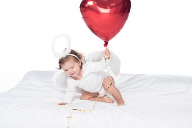 Little angel with wings and nimbus holding heart balloon, isolated on white stock vector