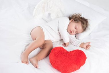 Little baby with sleeping on bed with heart, isolated on white stock vector