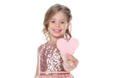 adorable happy child holding heart, isolated on white