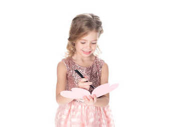 adorable child writing valentines greeting card, isolated on white