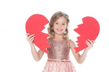 smiling child holding broken heart, isolated on white