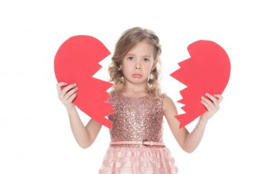 upset child holding broken heart, isolated on white