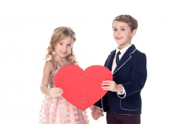 cute little kids holding broken heart symbol and smiling at camera isolated on white