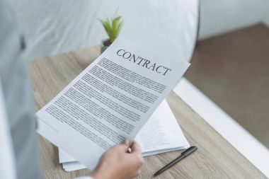 Cropped image of businesswoman holding contract stock vector