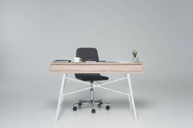 office table with empty chair on gray