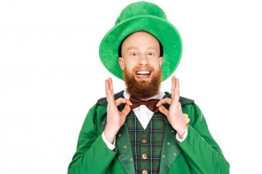 excited man in green leprechaun costume and bow tie, isolated on white
