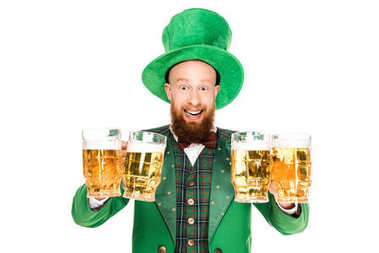 excited leprechaun celebrating st patricks day with glasses of beer, isolated on white