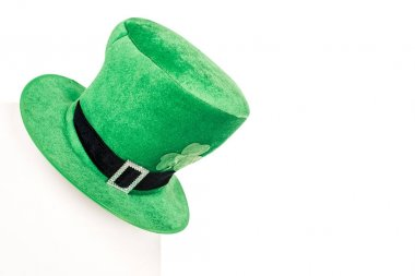 close-up view of green hat with clover isolated on white