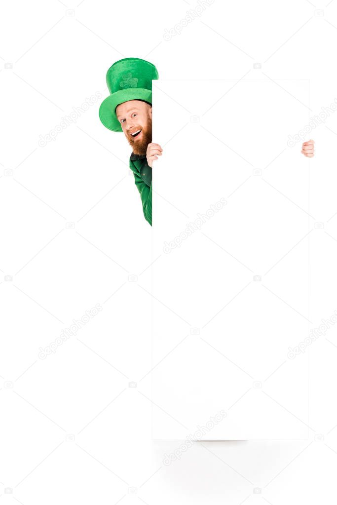 leprechaun in green suit holding blank placard, isolated on white