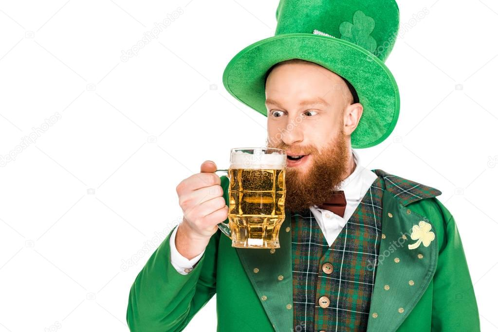 leprechaun celebrating st patricks day with beer, isolated on white