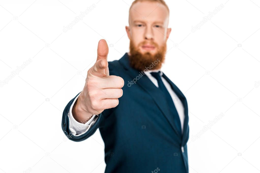 close-up view of bearded businessman pointing at camera isolated on white