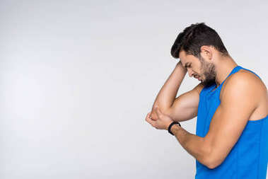 side view of young man with arm pain isolated on white