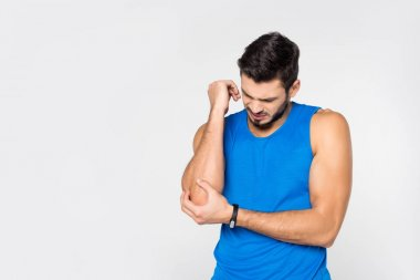 handsome young man with arm pain isolated on white
