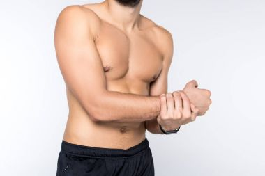 cropped shot of young man showing his muscles isolated on white