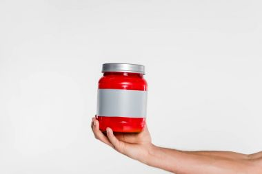 cropped shot of man holding sport supplement jar isolated on white