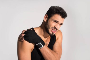 close-up portrait of young fighter with shoulder pain