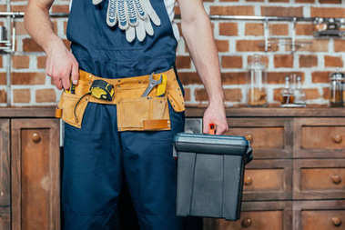 mid section of home master with tool belt holding toolbox