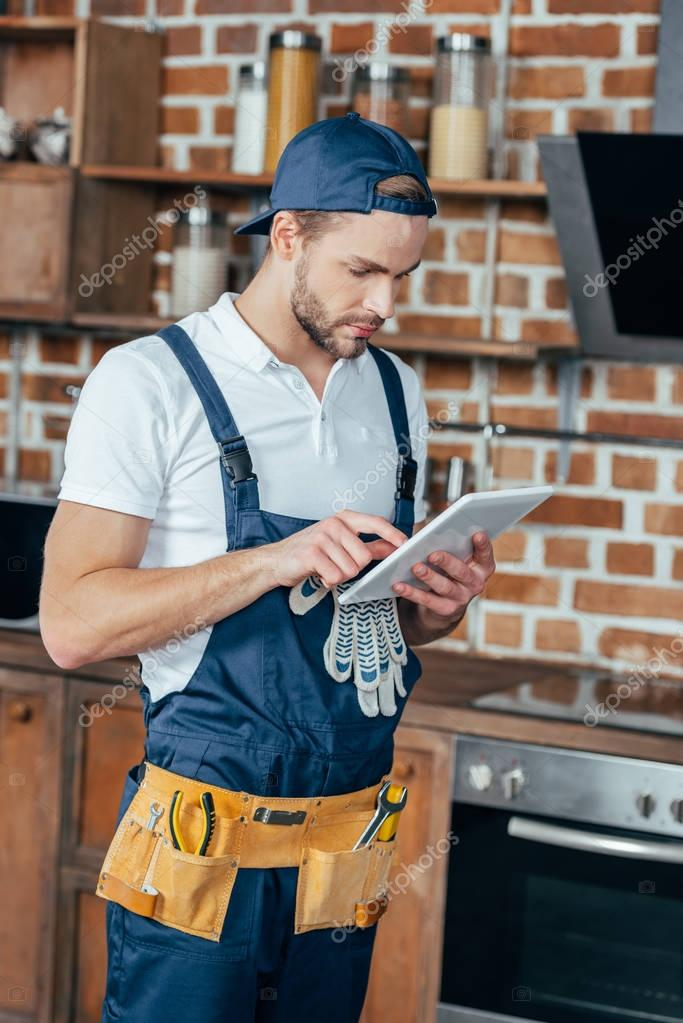 handsome young professional home master using digital tablet