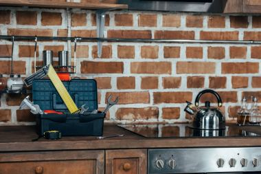 close-up view of toolbox with various tools and kitchen appliances