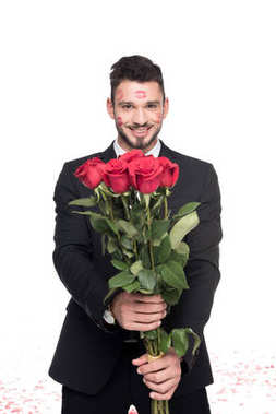 man with lips traces on face showing bouquet of roses isolated on white, valentines day concept
