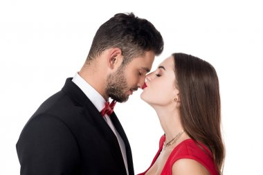 side view of girlfriend kissing boyfriends nose isolated on white