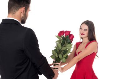 boyfriend presenting bouquet of roses to girlfriend isolated on white