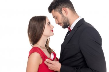 side view of boyfriend proposing girlfriend isolated on white