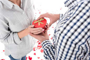 cropped image of girlfriend giving boyfriend present box isolated on white, valentines day concept