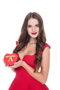 attractive girl in red dress holding present box isolated on white, valentines day concept