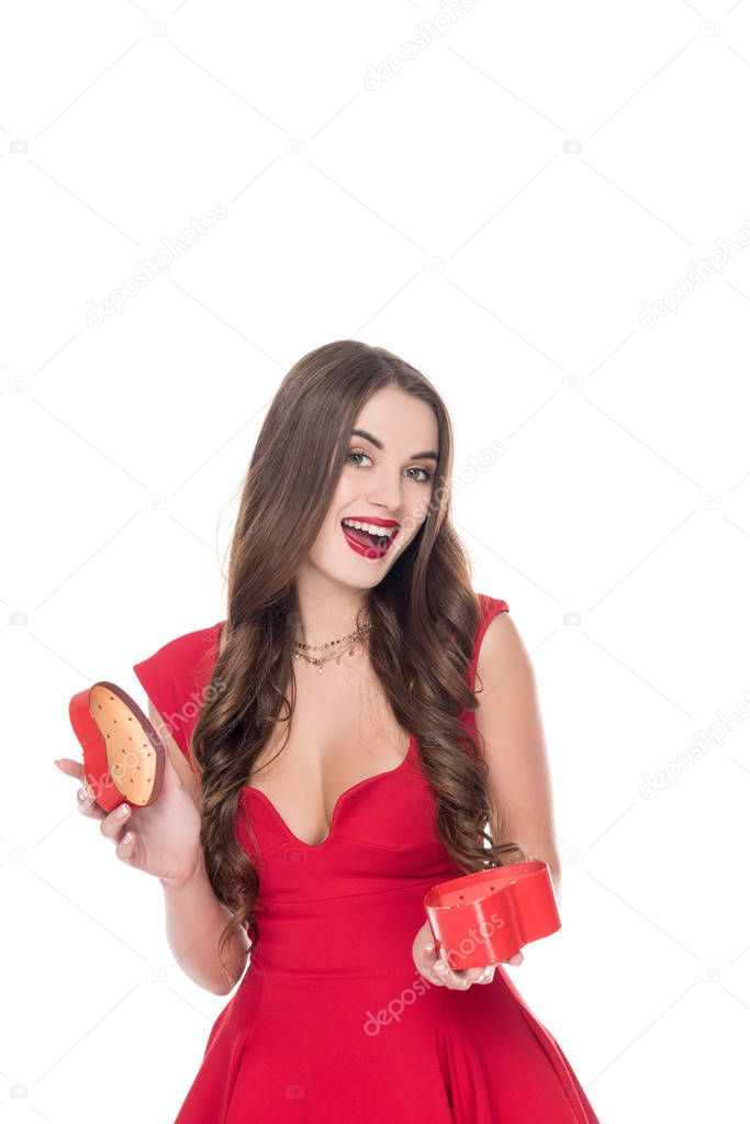laughing girl in dress holding present box isolated on white, valentines day concept