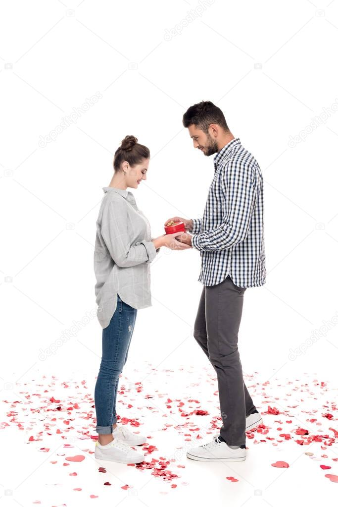 boyfriend giving girlfriend present box isolated on white, valentines day concept