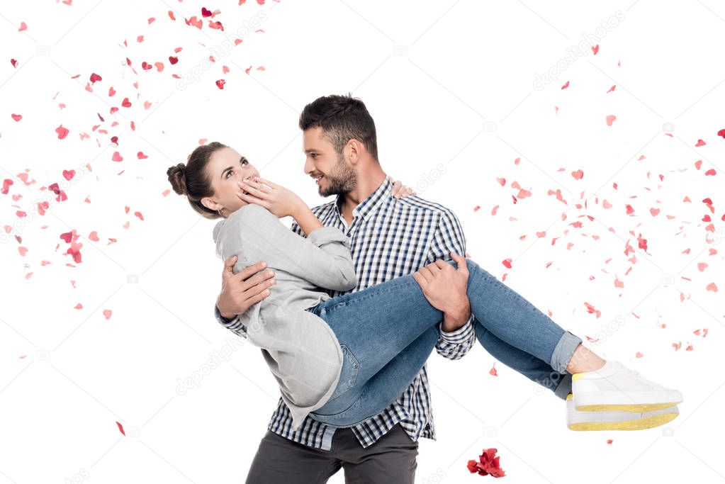 boyfriend carrying girlfriend isolated on white, valentines day concept