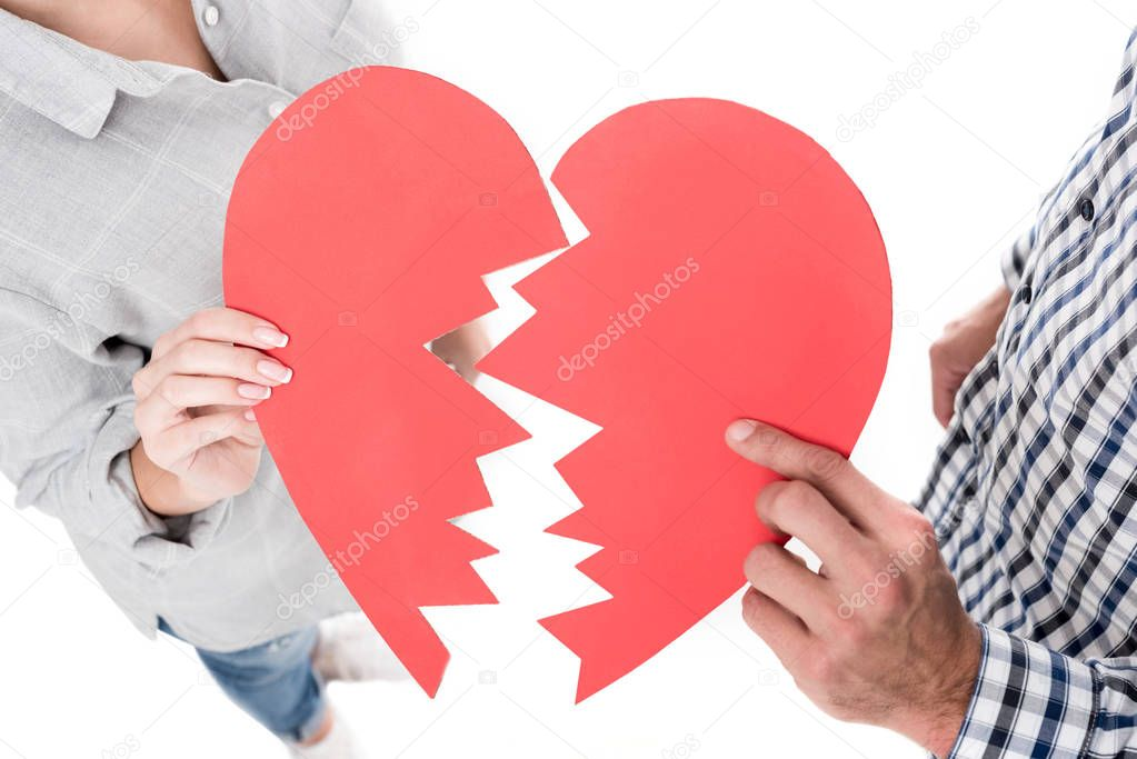 cropped image of couple holding two pieces of paper heart isolated on white, valentines day concept