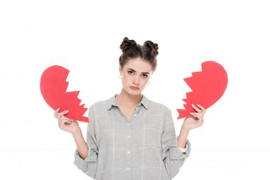 upset girl holding two pieces of paper heart isolated on white, valentines day concept