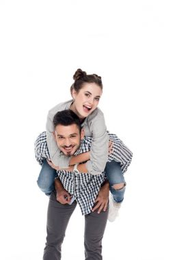 happy boyfriend giving piggyback to girlfriend isolated on white