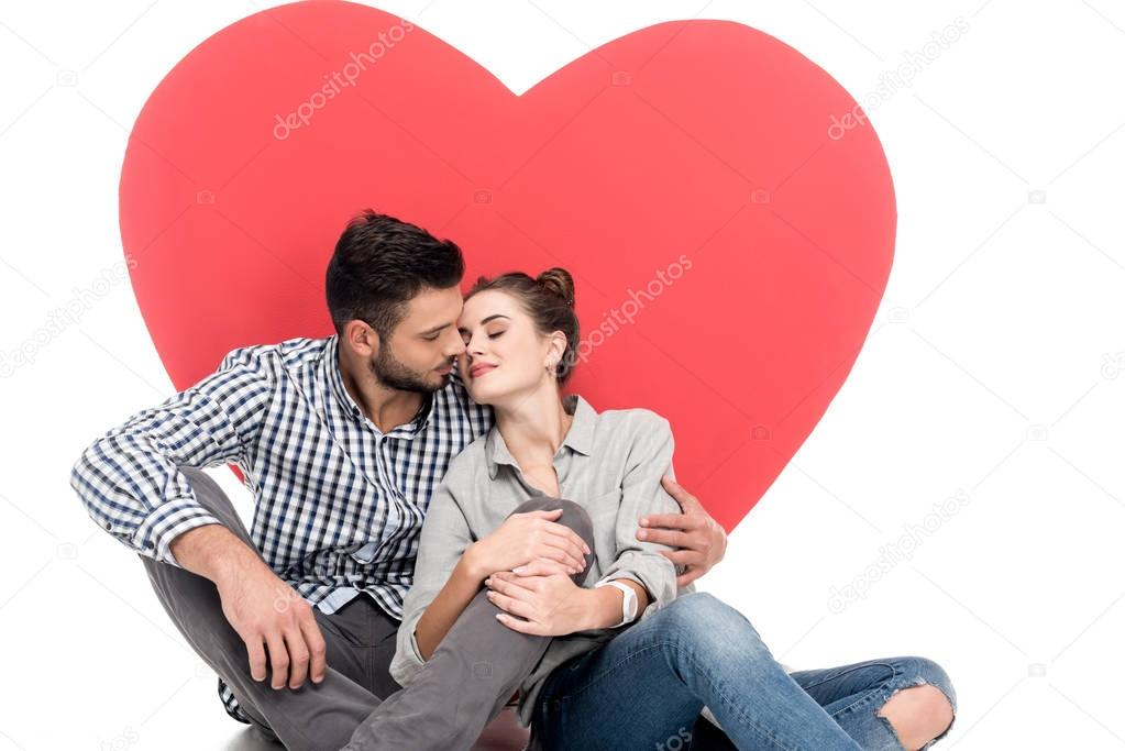 Couple going to kiss near big heart isolated on white, valentines day concept stock vector