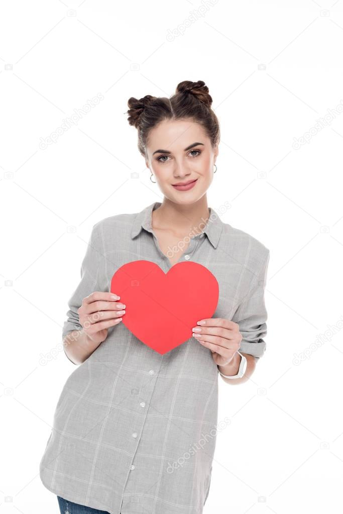 smiling girl holding red paper heart isolated on white, valentines day concept