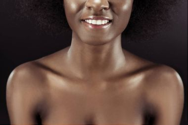 cropped shot of smiling african american woman isolated on black