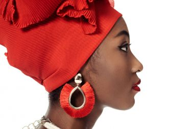 Side view of young african american woman in wire head wrap isolated on white stock vector